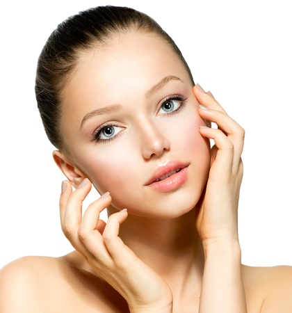 Beautiful Young Woman with Fresh Clean Skin touching her Face  Stock Photo - 17935507