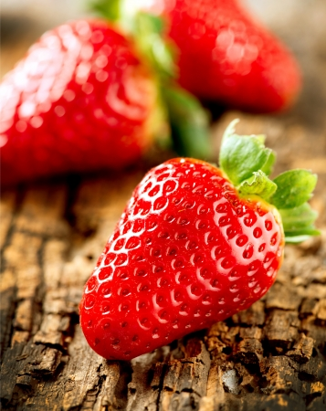 srawberries: Strawberry over Wooden Background  Strawberries close-up  Stock Photo
