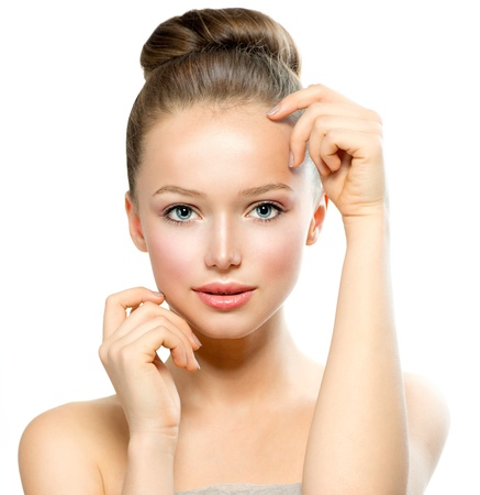 beauty salon face: Beautiful Young Woman with Fresh Clean Skin touching her Face