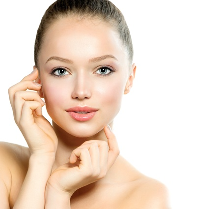 Beautiful Young Woman with Fresh Clean Skin touching her Face Stock Photo - 17935511