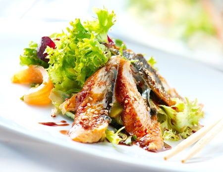 black dish: Salad With Smoked Eel with Unagi Sauce  Japanese Food