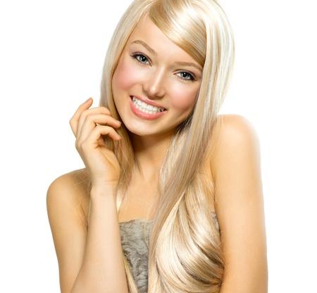 hair highlights: Chica rubia hermosa aislado en un fondo blanco Foto de archivo