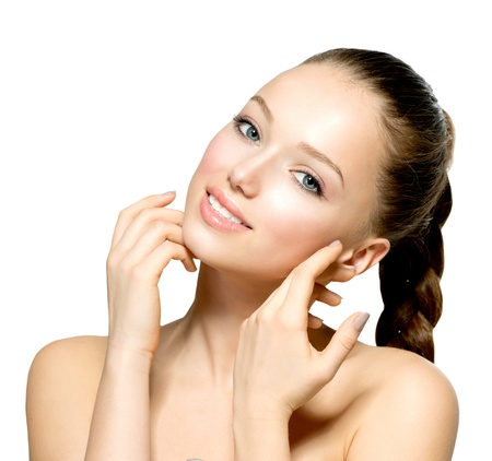 Beautiful Young Woman with Fresh Clean Skin touching her Face Stock Photo - 18294907