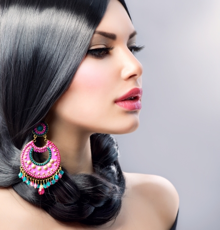 earring: Beauty Woman With Long Black Hair  Hairstyle Stock Photo