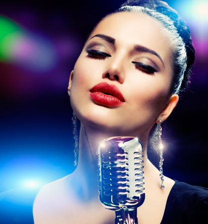 singers: Singer Woman with Retro Microphone  Vintage Style  Stock Photo