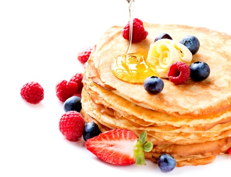 Pancake  Crepes With Berries  Pancakes stack isolated on White  photo