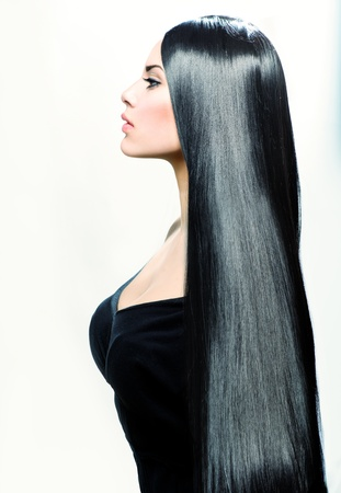 long straight hair: Beauty Girl with Long Straight Black Healthy Hair Stock Photo