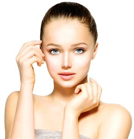 Beautiful Young Woman with Fresh Clean Skin touching her Face  photo