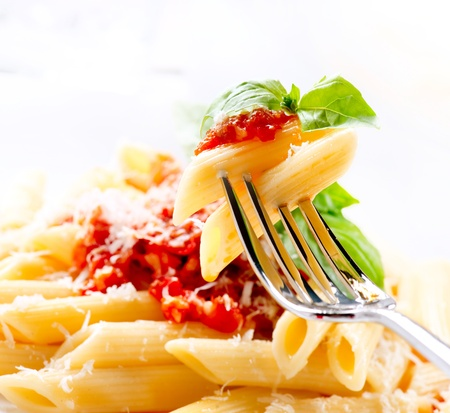 Pasta Penne with Bolognese Sauce, Basil and Parmesan Stock Photo - 18696901