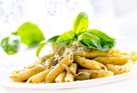 Penne Pasta with Pesto Sauce  Italian Cuisine  Stock Photo - 18697284