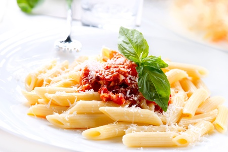 Pasta Penne with Bolognese Sauce, Basil and Parmesan Stock Photo - 18697323