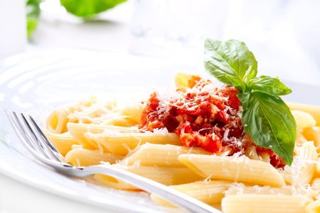 Pasta Penne with Bolognese Sauce, Basil and Parmesan Stock Photo - 18697335