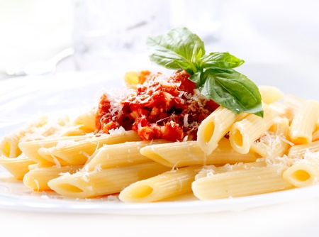 Pasta Penne with Bolognese Sauce, Basil and Parmesan Stock Photo - 18697278