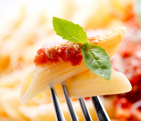 Pasta Penne with Bolognese Sauce, Basil and Parmesan Stock Photo - 18697276