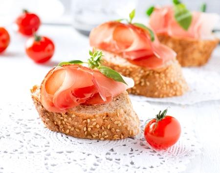 prosciutto: Jamon  Slices of Bread with Spanish Serrano Ham  Prosciutto