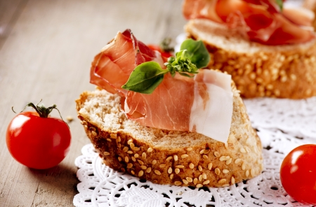 Jamon  Slices of Bread with Spanish Serrano Ham  Prosciutto  photo