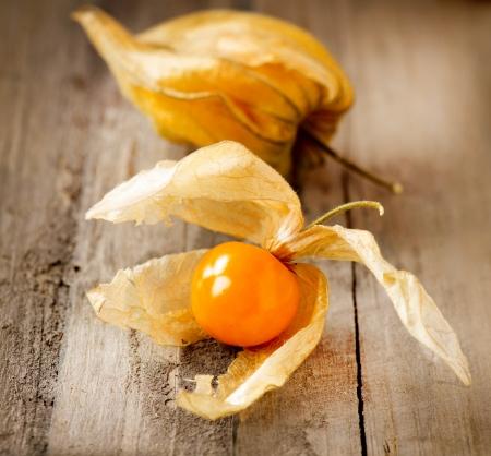Physalis fruit over wood  photo