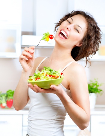 Diet  Beautiful Young Woman Eating Vegetable Salad  Diet  Beautiful Young Woman Eating Vegetable Salad  Stock Photo