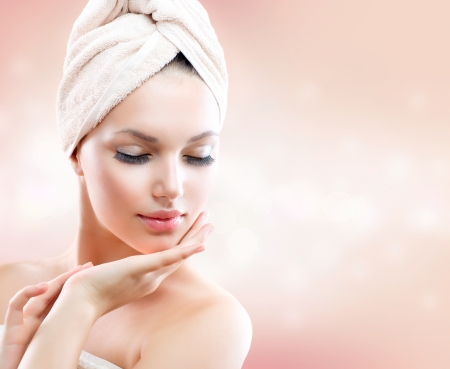 moisturize: Beautiful Girl After Bath Touching Her Face  Skincare Stock Photo