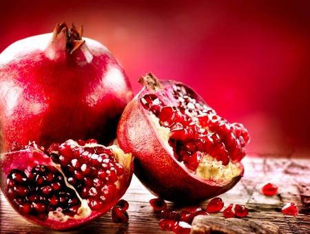 Pomegranates over Red Background  Organic Bio fruits photo