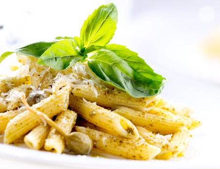 Penne Pasta with Pesto Sauce  Italian Cuisine Stock Photo - 18696910