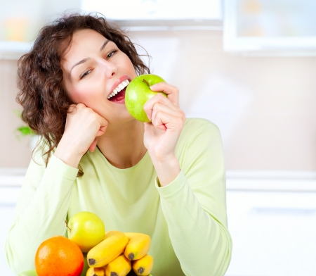 Dieting concept  Healthy Food  Young Woman Eats Fresh Fruit Stock Photo - 18676075