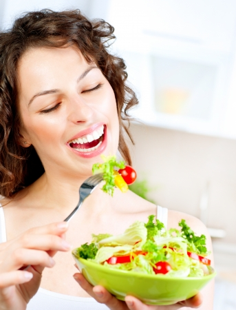 Diet  Beautiful Young Woman Eating Vegetable Salad  photo