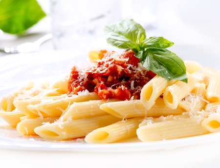 Pasta Penne with Bolognese Sauce, Basil and Parmesan  Stock Photo - 18697293