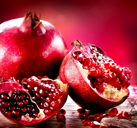 pomergranate: Pomegranates over Red Background  Organic Bio fruits