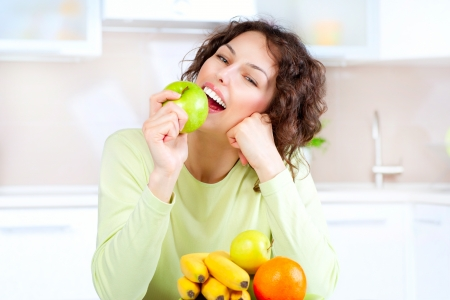 Dieting concept  Healthy Food  Young Woman Eats Fresh Fruit Stock Photo - 18690590