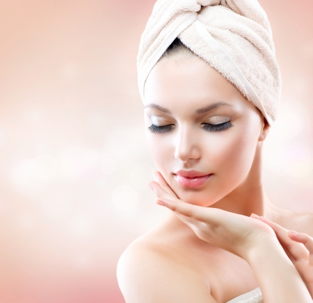 facial  spa: Beautiful Girl After Bath Touching Her Face  Skincare  Stock Photo