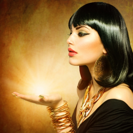 jewel hands: Egyptian Style Woman with Magic Light in Her Hand  Stock Photo