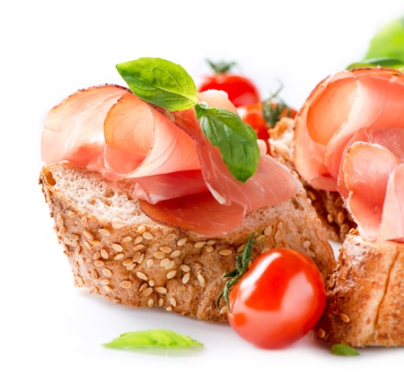Jamon  Slices of Bread with Spanish Serrano Ham over White  Stock Photo - 18892589