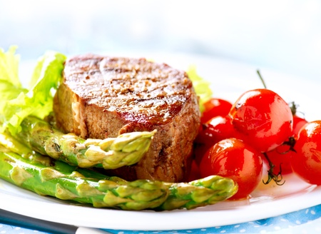 main: Grilled Beef Steak Meat with Fried Potato, Asparagus, Tomatoes