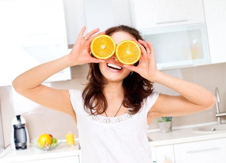 Portrait of Young and Healthy Funny Woman with Orange over Eyes  Stock Photo - 18941093
