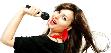 Beautiful Singing Girl  Beauty Woman with Microphone over White  photo