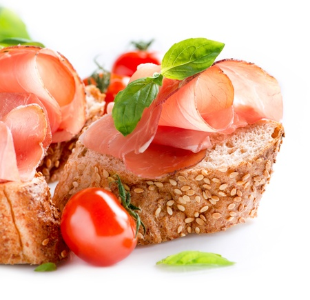 Jamon  Slices of Bread with Spanish Serrano Ham Served as Tapas  photo