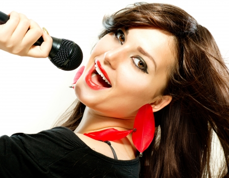 Beautiful Singing Girl  Beauty Woman with Microphone over White  Stock Photo - 18881184
