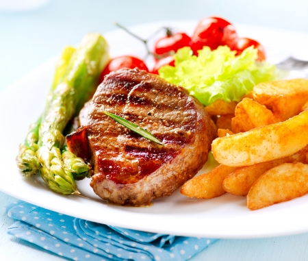 steak dinner: Grilled Beef Steak Meat with Fried Potato, Asparagus, Tomatoes