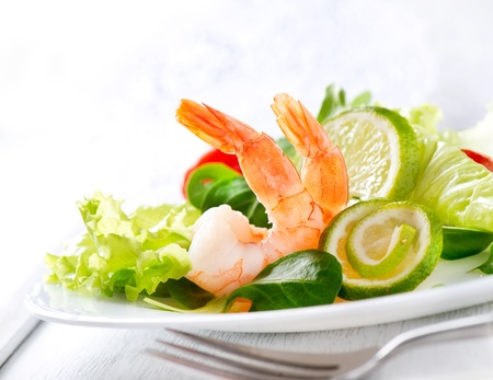 Prawn salad  Healthy Shrimp Salad with mixed greens and tomatoes  photo