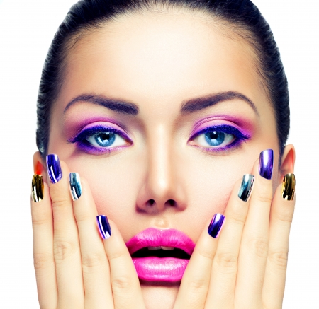 polish: Beauty Makeup  Purple Make-up and Colorful Bright Nails Stock Photo