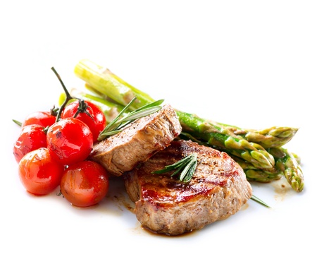 white  background: Grilled Beef Steak Meat over White Stock Photo