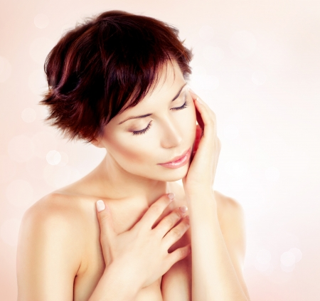 Beautiful Young Woman touching her Face  Skincare  photo