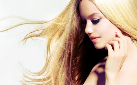 woman blowing: Beauty Blond Girl With Long Healthy Blowing Hair  Stock Photo
