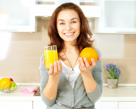 Healthy Girl with Orange Juice in the Kitchen Stock Photo - 19631877