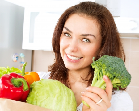 Happy Young Woman with vegetables in shopping bag Stock Photo - 19631893