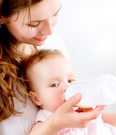 Feeding Baby  Baby eating milk from the bottle photo
