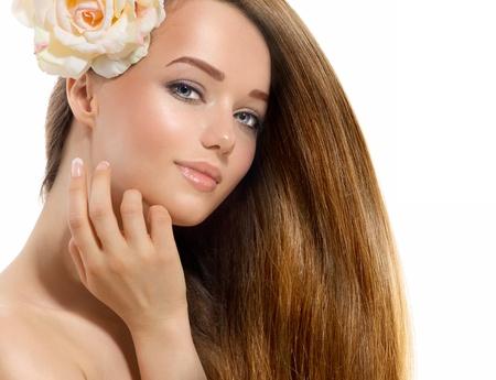 beautiful eye: Beautiful Model with Rose Flower Touching her Face