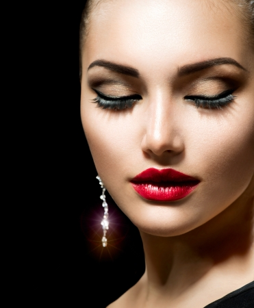 earring: Beauty Woman with Perfect Make up  Stock Photo