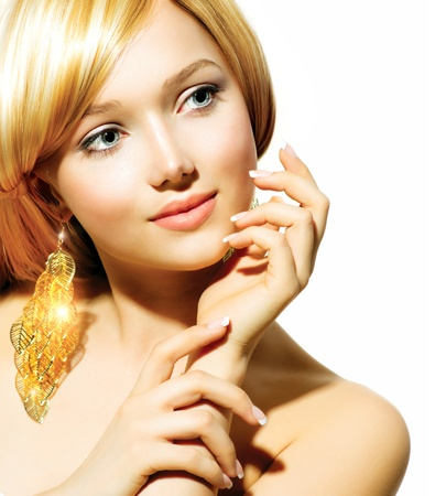 Beauty Blonde Fashion Model Girl With Golden Earrings  photo